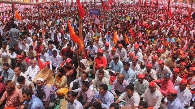 Workers gather at Azad Maidan, Mumbai, on Tuesday.(BHUSHAN KOYANDE/HT)