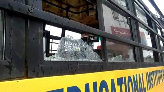 The damaged school bus which was attacked by stone-pelters at Zavoora area in Shopian district of south Kashmir on Wednesday.(PTI)