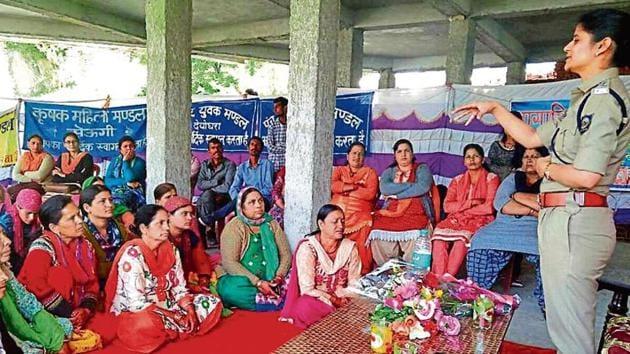 Kullu SP Shalini Agnihotri (right) addressing women during a meeting under the 'Sehbhagita Aapki Aur Humari' initiative in Kullu.(HT File)
