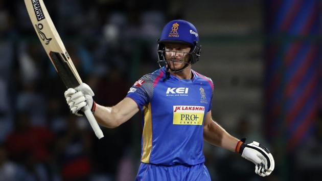 Rajasthan Royals' Jos Buttler raises his bat after scoring a quick fifty during their IPL 2018 match against Delhi Daredevils in New Delhi on Wednesday.(AP)