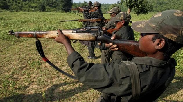 Maoists train in a forested area at Dumariya block in Gaya district recently.(AP File)