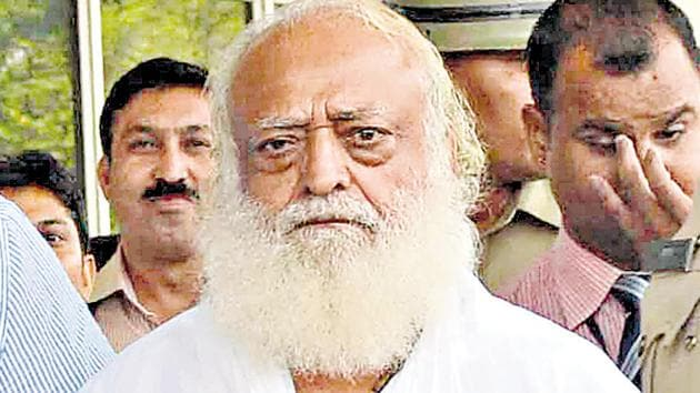 The special court (Pocso Act) on April 25 awarded life imprisonment to Asaram Bapu till death. He is accused of raping a minor girl in 2013 at his ashram in Manai village near Jodhpur.(HT FILE PHOTO)