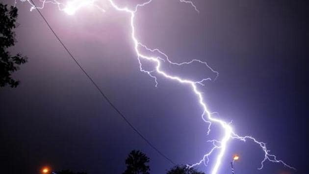 A thunderbolt strikes in the sky.(HT File Photo)