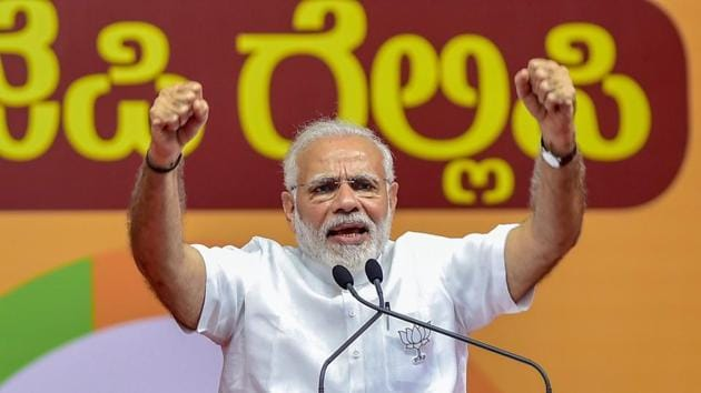 Prime Minister Narendra Modi addresses a public rally for the Karnataka assembly elections, in Bengaluru on May 3.(PTI photo)