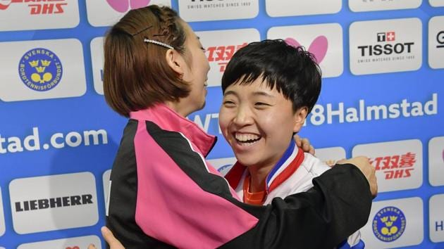 Seo Hyowon, right, from South Korea and Kim Song I from North Korea together in Halmstad on Thursday after North and South Korea combined their women's teams at the table tennis team world championships.(AP)