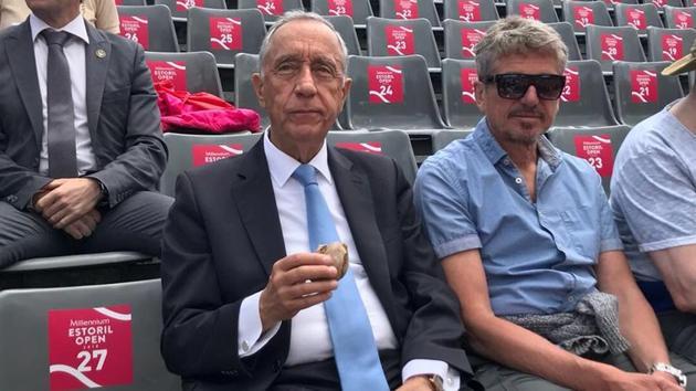 Marcelo Rebelo de Sousa, president of Portugal, having some refreshments while enjoying the action at the Estoril Open tennis tournament.(Twitter - Estoril Open)