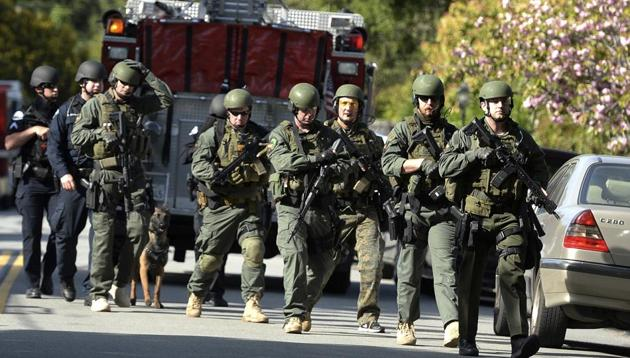 Law enforcement personnel head to the scene of a shooting in Mill Valley, California.(AP Photo)