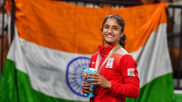 Vinesh Phogat, from the Phogat famlily which broke a glass ceiling in Indian wrestling through their champion women grapplers, celebrates her gold medal at in the women's 55kg event at the 2018 Commonwealth Games (CWG 2018) in Gold Coast last month.(PTI)