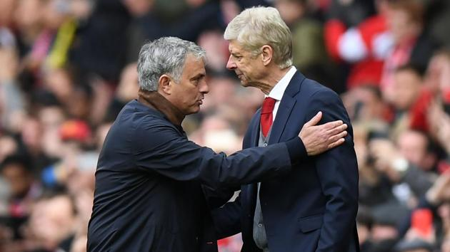 Jose Mourinho and Arsene Wenger have a long and chequered history.(AFP)