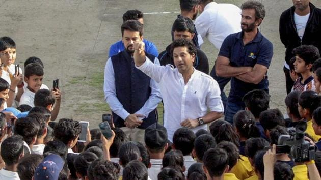 Sachin Tendulkar interacts with young cricketers at the HPCA Stadium in Dharamsala on Thursday.(PTI)