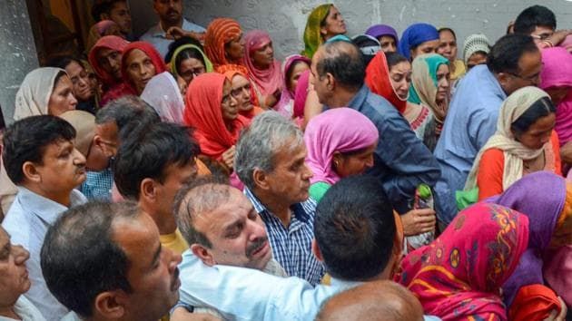 Family members of officer Shail Bala Sharma mourn after she was allegedly shot dead by a hotel owner in Kasauli town, where Sharma had yesterday gone to supervise the demolition of unauthorised construction, in Mandi on Wednesday.(PTI Photo)