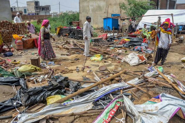 People salvage their household items after Wednesday night's massive storm, near Bharatpur in Rajasthan.(PTI)