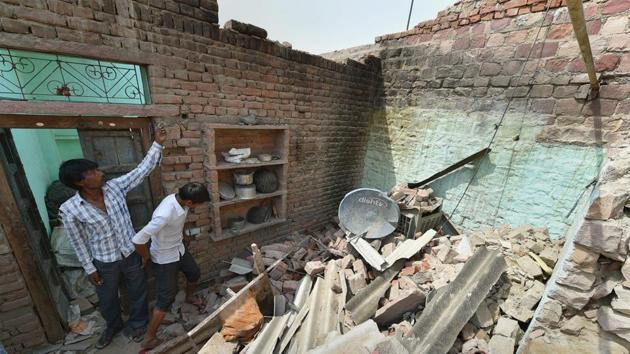 A man in Agra stands in his house that collapsed in the Wednesday's powerful storm. Agra district bore the brunt of the storm that killed more than 100 people in north and west India.(PTI)