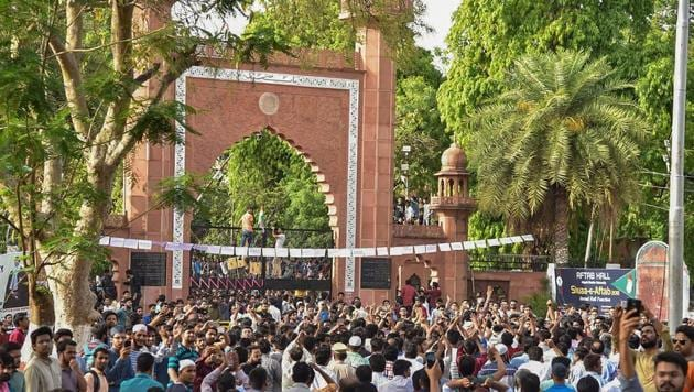 Protest outside the gate of Aligarh Muslim University campus in Aligarh on May 3.(PTI Photo)