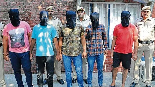 The accused, who allegedly killed a law student, in police custody in Rohtak on Friday.(HT Photo)