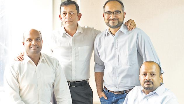 (From left) Vijay Arisetty, Vivaik Bharadwaaj, Shreyans Daga and Abhishek Kumar, founders of the apartment security and visitor management system, MyGate, are all smiles after the successful launch of their app in Pune.(HT PHOTO)