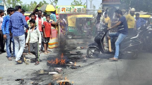 Locals block road with burning tyres to demand water and power in Bharatpur on Saturday.(HT PHOTO)