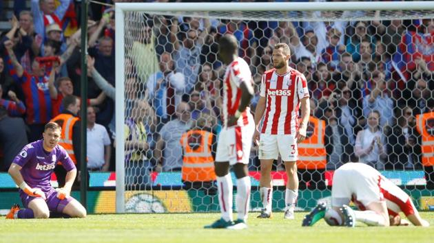 Stoke City players react to conceding a late goal from Crystal Palace that confirmed their relegation from the Premier League.(REUTERS)