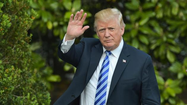 US President Donald Trump waves to the press after he arrived at the White House on May 4, 2018 in Washington, DC.(AFP)