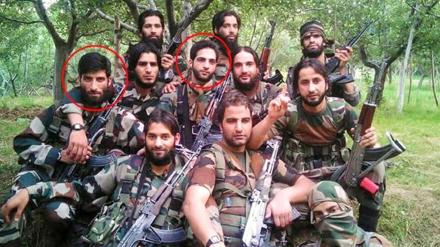 This viral Facebook photo shows Burhan Wani (in the middle) and Naseer Ahmed Pandit (second row, extreme left), posing with other militants.(Facebook photo)