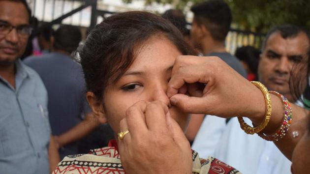 A parent removes the nose pin of a student at the Government Model Senior Secondary School exam centre in Sector 23, Chandigarh.(Sikander Singh Chopra/HT Photo)