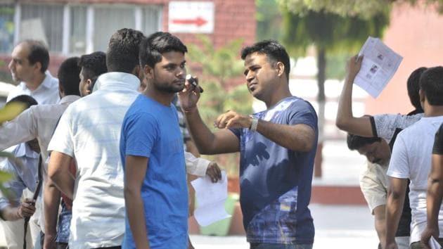 NEET aspirants pass through tight security at NEET 2018 examination centres in Lucknow on Sunday.(Deepak Gupta/HT photo)