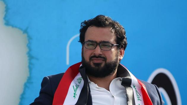 """Muntazer al-Zaidi, an Iraqi journalist famous for throwing a shoe at former US president George W. Bush in 2008, attends a rally in Baghdad on May 4, 2018 for the """"Marching Towards Reform"""" alliance between Shiite leader Moqtada al-Sadr and the communist party, ahead of the May 12 parliamentary elections(AFP)"""