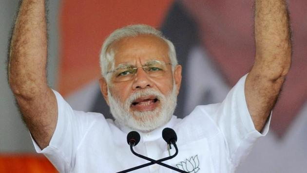 Prime Minister Narendra Modi gestures as he speaks during a public rally ahead of the Karnataka assembly election 2018 in Tumakuru on Saturday.(PTI)