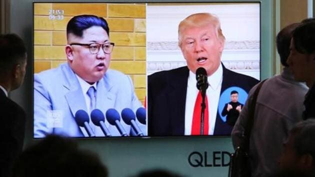 People watch a TV screen showing file footage of U.S. President Donald Trump, right, and North Korean leader Kim Jong Un during a news program at the Seoul Railway Station in Seoul, South Korea.(AP File Photo)