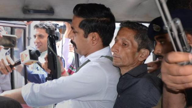 Police produce Vijay Singh, who allegedly shot dead Assistant Town and Country Planning officer Shail Bala Sharma during an anti-demolition drive on May 1, in a court in Kasauli.(PTI File Photo)
