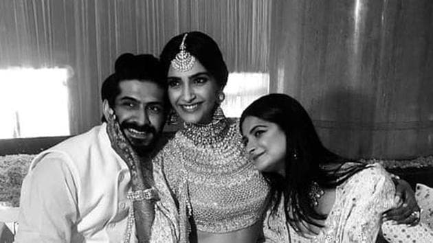 Sonam Kapoor with brother Hashvardhan and Rhea at her mehendi party.(Instagram)