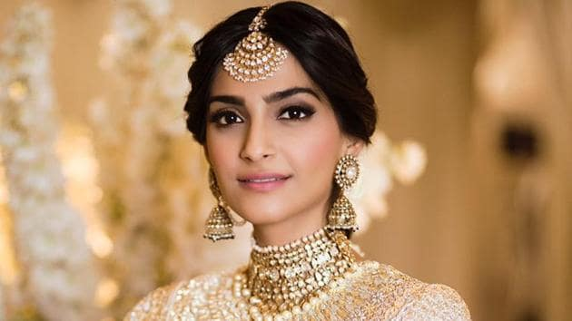 Sonam Kapoor wore a beautiful white-golden dress to her sangeet on Monday.(Viral Bhayani)