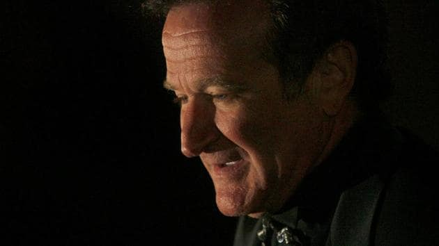 Actor Robin Williams arrives at singer-songwriter Elton John's 60th birthday party in New York.(REUTERS)
