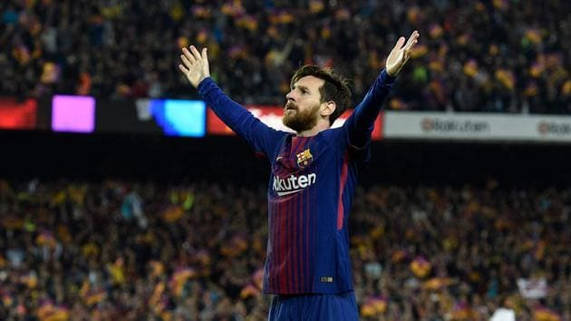 FC Barcelona's Lionel Messi celebrates after scoring during the El Clasico La Liga match against Real Madrid at the Camp Nou in Barcelona on Sunday.(AFP)