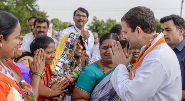 """Congress President Rahul Gandhi meets supporters during an election campaign ahead of Karnataka Assembly elections at Gajendragarh in Gadag district on Friday. Political analysts suggest that the polls this year will see strategic voting by the Muslims, who are wary of reposing their faith in other """"secular"""" outfits.(PTI file photo)"""