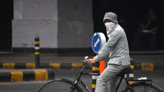 A man wears face protection against air pollution while riding on a bicycle in New Delhi.(AFP File Photo)
