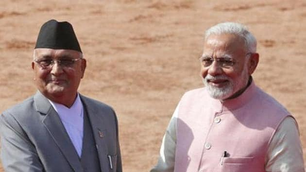 Prime Minister Narendra Modi with Nepalese Prime Minister KP Oli as the latter arrives for a ceremonial reception in New Delhi on April 7, 2018.(AP File Photo)