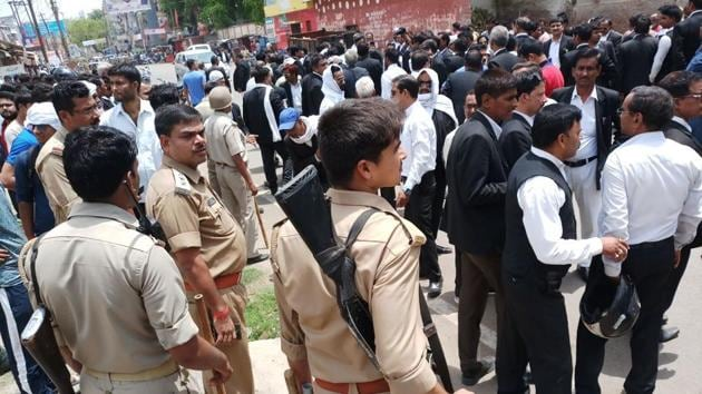 Lawyers and police at the site of the shooting in Allahabad on Thursday.(HT PHOTO)