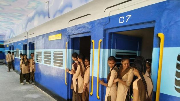 """The classrooms of this school have been painted like passenger compartments, the principal's office looks like an engine, and the veranda is the """"platform"""", where students hang out.(HT FILE PHOTO)"""
