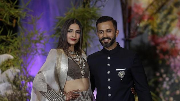 Bollywood actor Sonam Kapoor and her husband Anand Ahuja pose for photographers at their wedding reception, Mumbai, May 9(PTI)