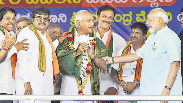 Prime Minister Narendra Modi and Bharatiya Janata Party's chief ministerial candidate BS Yeddyurappa during Karnataka election campaign rally at Chamarajanagar on May 1.(PTI file photo)