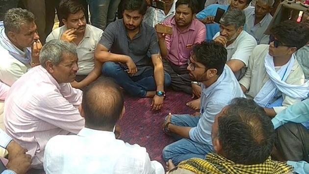 Gujarat Independent MLA Jignesh Mevani talks to Dalit families in Khairthal in Alwar on Sunday.(HT Photo)