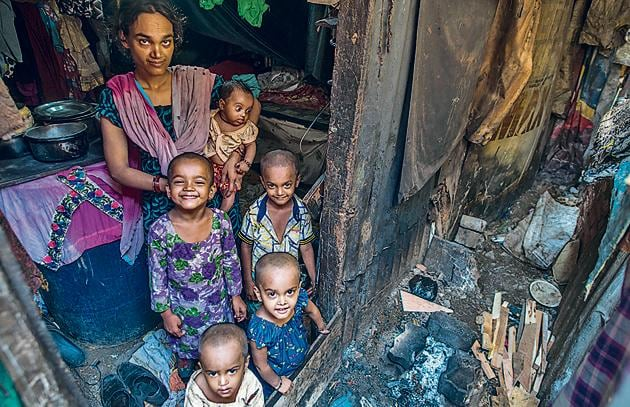 A family at one of the slums in M-East ward. Low immunisation rates with poor living conditions exposes the children and the families to a number of diseases.(Pratik Chorge/HT Photo)