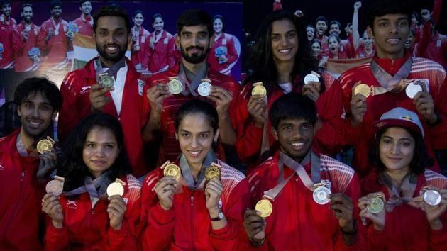 Indian badminton players from top left - H.S Prannoy, Kidambi Srikanth, P.V. Sindhu, Chirag Chandrashekhar Shetty, from bottom left, Pranaav Jerry Chopra, Sikki Reddy, Saina Nehwal, Satwiksairaj Rankireddy and Ashwin Ponnappa won medals during the 2018 Commonwealth Games.(AP)