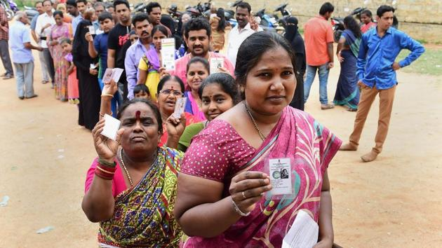 People queue up to cast their ballot during the polling day for the Karnataka Assembly election 2018 in Bengaluru on Saturday.(PTI Photo)
