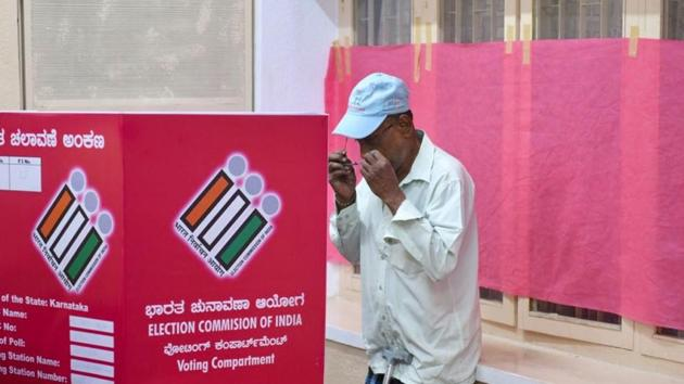 A man casts his vote at a pink booth, an election centre entirely managed by women, in Bengaluru on Saturday, May 12, 2018.(Arijit Sen/ HT Photo)