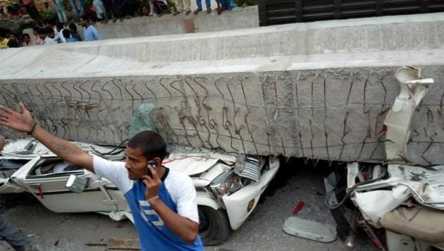 Cars crushed under the portion of the flyover that collapsed in Varanasi.(HT Photo)
