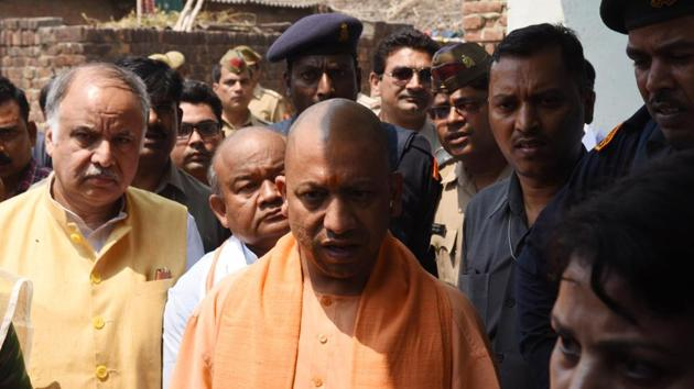 Yogi Adityanath was in Kasganj to meet a family whose three members were recently murdered. He also reviewed developmental works and law and order situation in the district.(HT/File Photo)