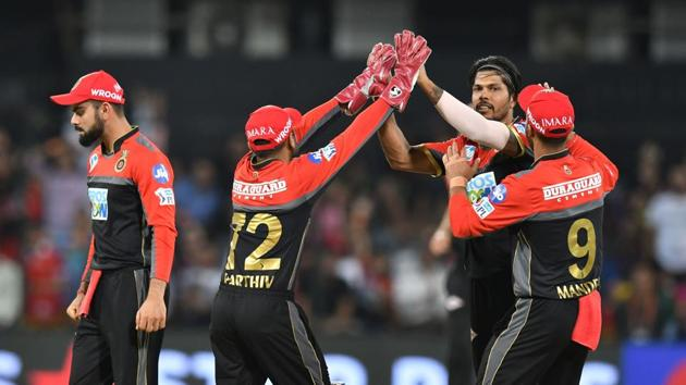 Umesh Yadav picked up 3/23, including the wickets of KL Rahul and Chris Gayle cheaply as Royal Challengers Bangalore thrashed Kings XI Punjab by 10 wickets to stay alive in the race for the play-offs.(AFP)