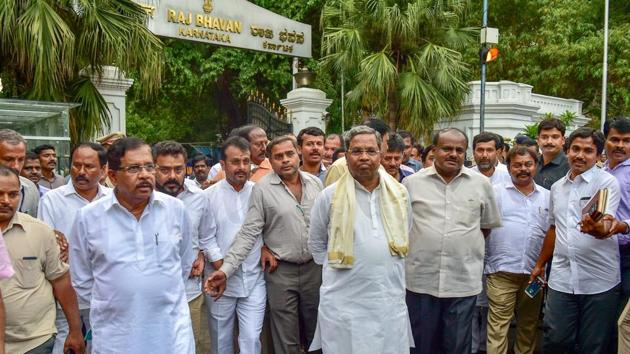 Outgoing Karnataka chief minister Siddaramaiah, JD(S) president HD Kumaraswamy with other leaders leave after a meeting with Governor Rudabhai Vajubhai Vala as Congress extends party support to JD(S) to form the new government after Karnataka Assembly Election results 2018 in Bengaluru on Tuesday.(PTI photo)